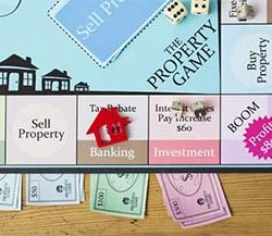 Monopoly board playing the game of buying real estate