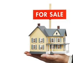 Hand Offering Real Estate with FOR SALE Sign on White